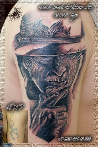 Фото перекрытия неудачно сделанной татуировки на плече.